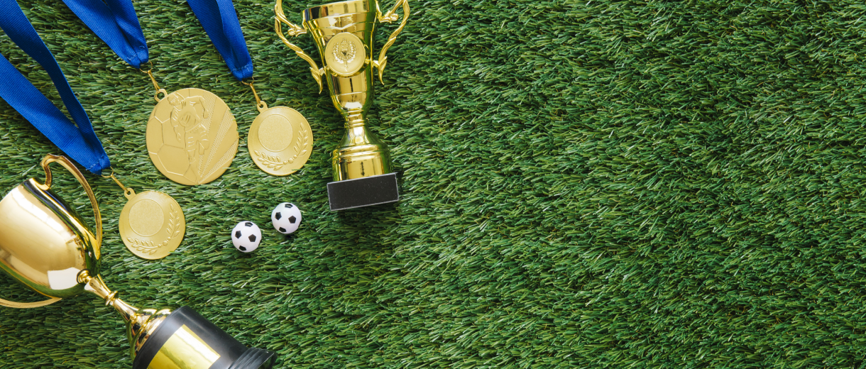 football-background-with-medals-trophy